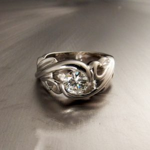 The finished ring cast in Platinum with a .71 CT diamond in the center