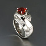 Oregon Sunstone; Red Sunstone set in a hand carved white gold setting with diamonds